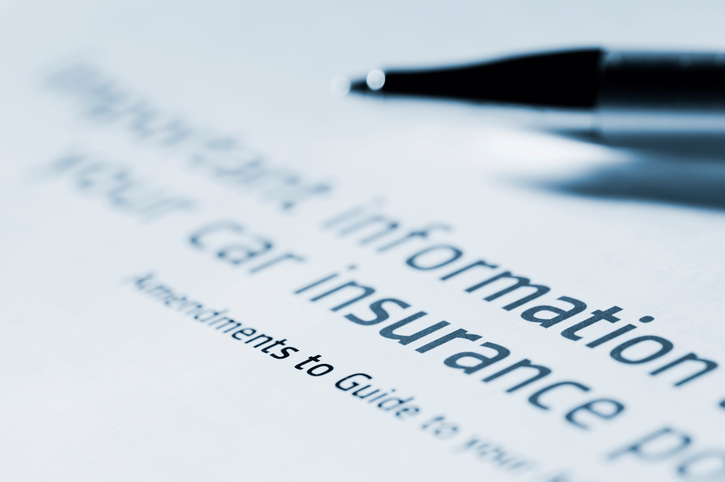 paper with car insurance information